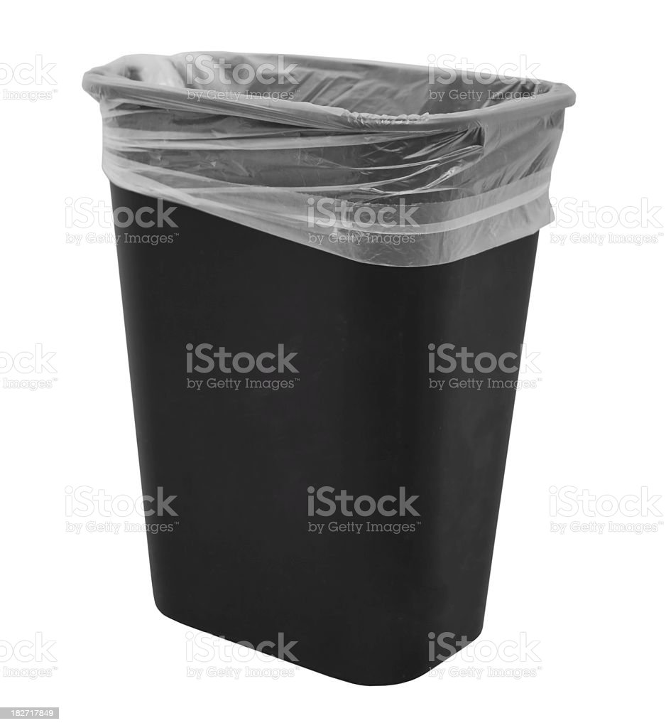 An empty rubbish bin with a plastic bag inside stock photo
