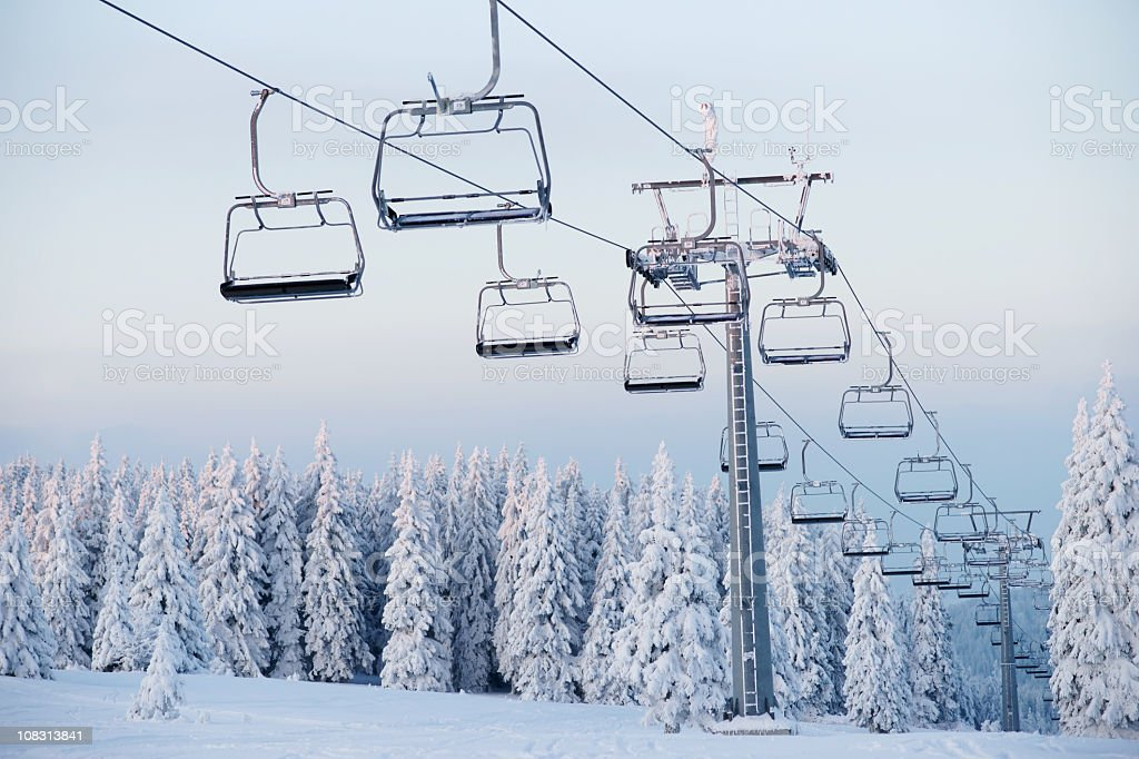 An empty ski lift during winter stock photo