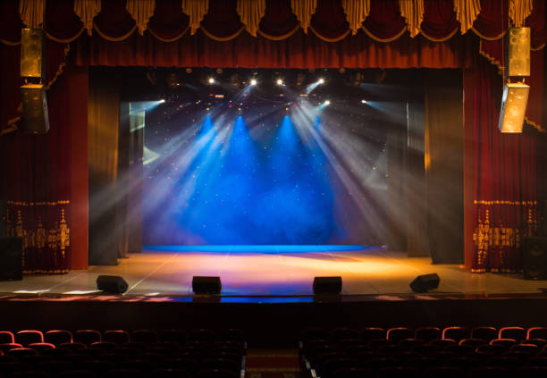 An empty stage of the theater, lit by spotlights and smoke - foto stock