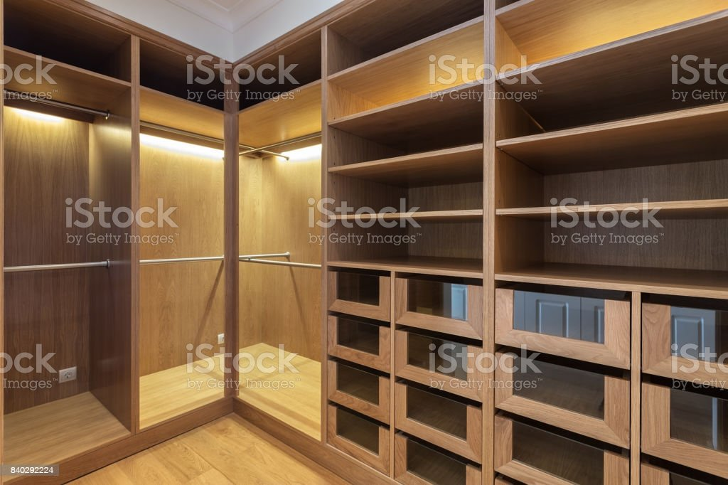 An empty wardrobe made of wood, for family. stock photo