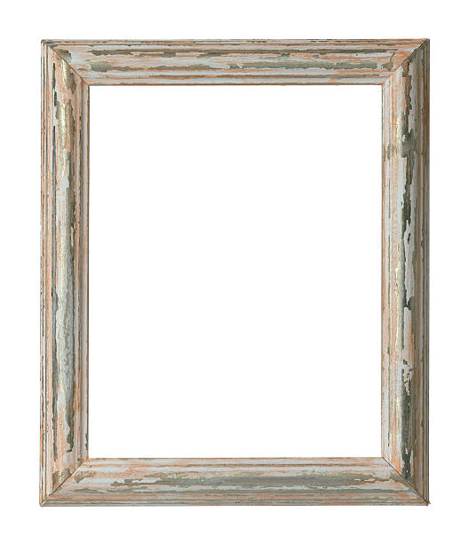 An empty weathered wooden frame on a white background stock photo