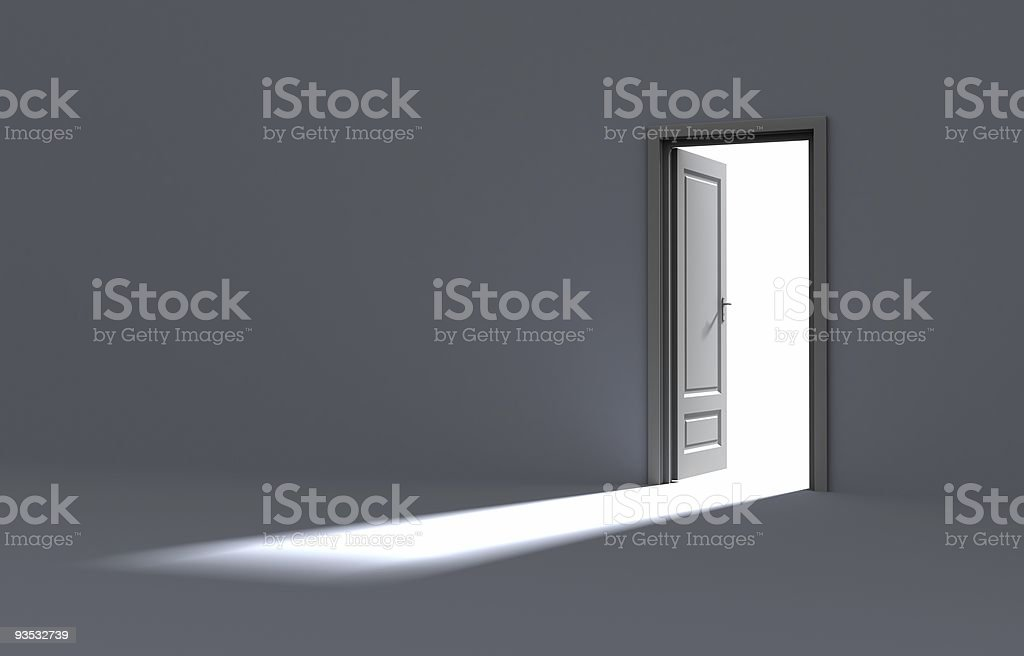 An empty white room with the door open and light shining in stock photo