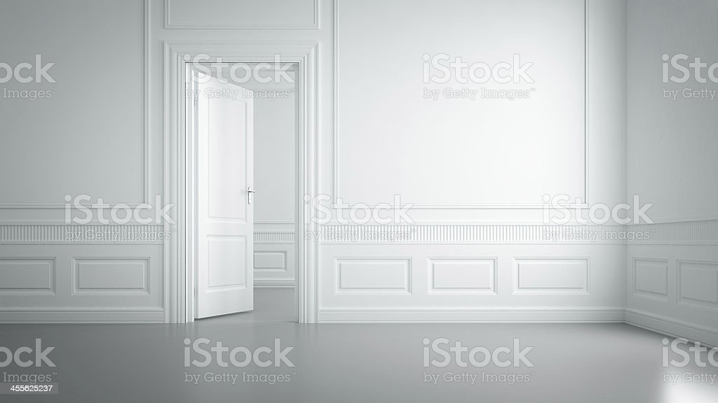 An empty white room with wall designs stock photo