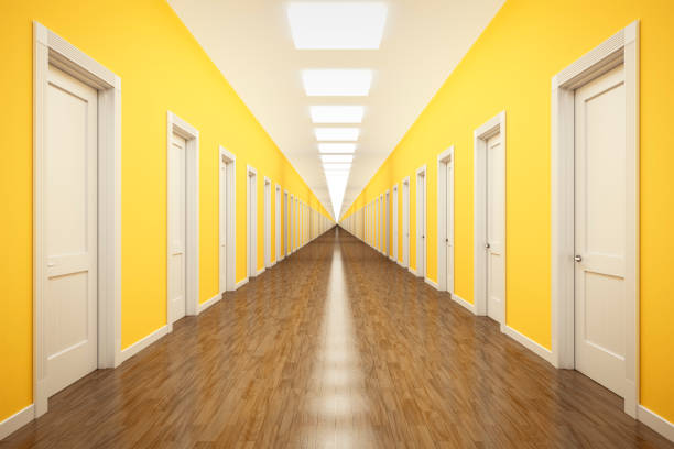 an endless corrior with lots of white doors stock photo