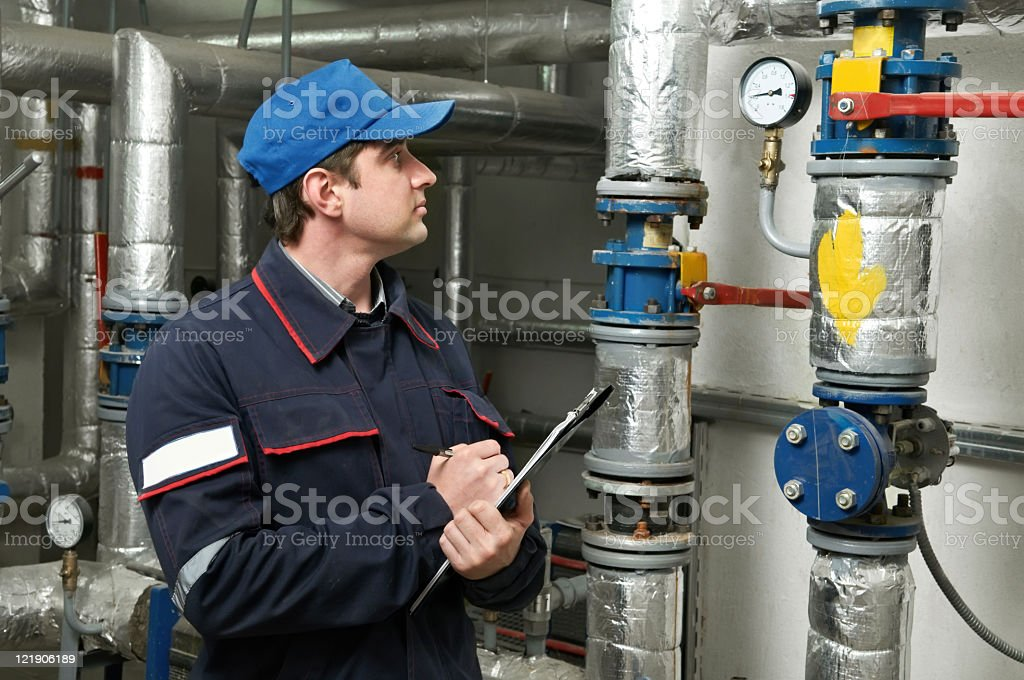 An engineer repairing the boiler room royalty-free stock photo