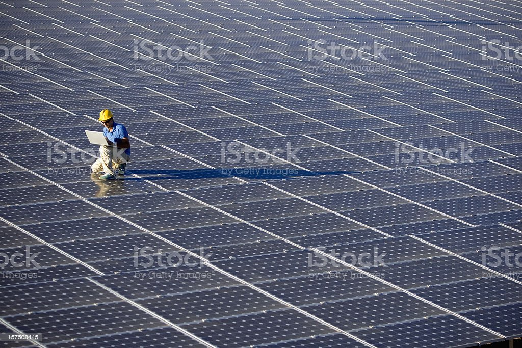 An engineer working at a photovoltaic farm stock photo