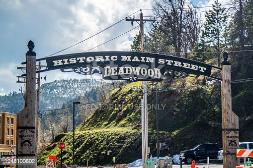 Deadwood, SD, USA - May 25, 2019: A welcoming signboard at the entry point of preserve historic place