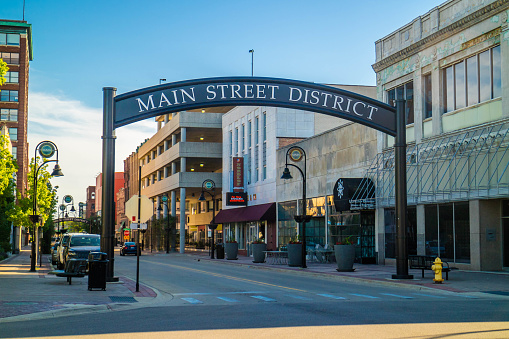 Rockford, IL, USA - June 4, 2017: A welcoming signboard of the Main Street District of the village