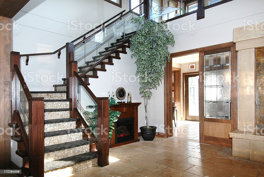An entry way into a house with elegant stairs stock photo