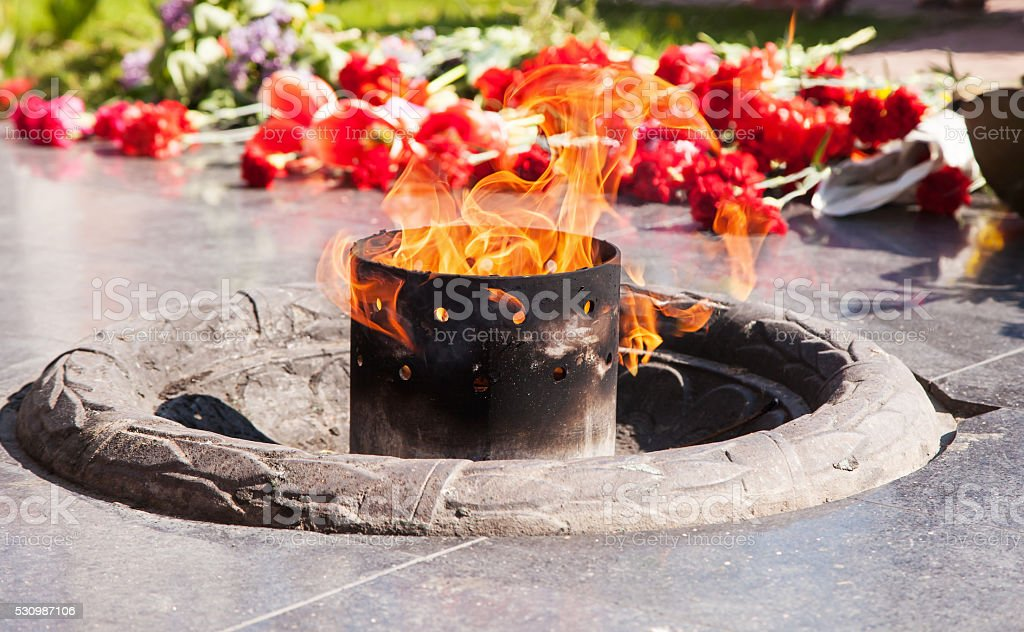 an eternal flame burns at the monument stock photo