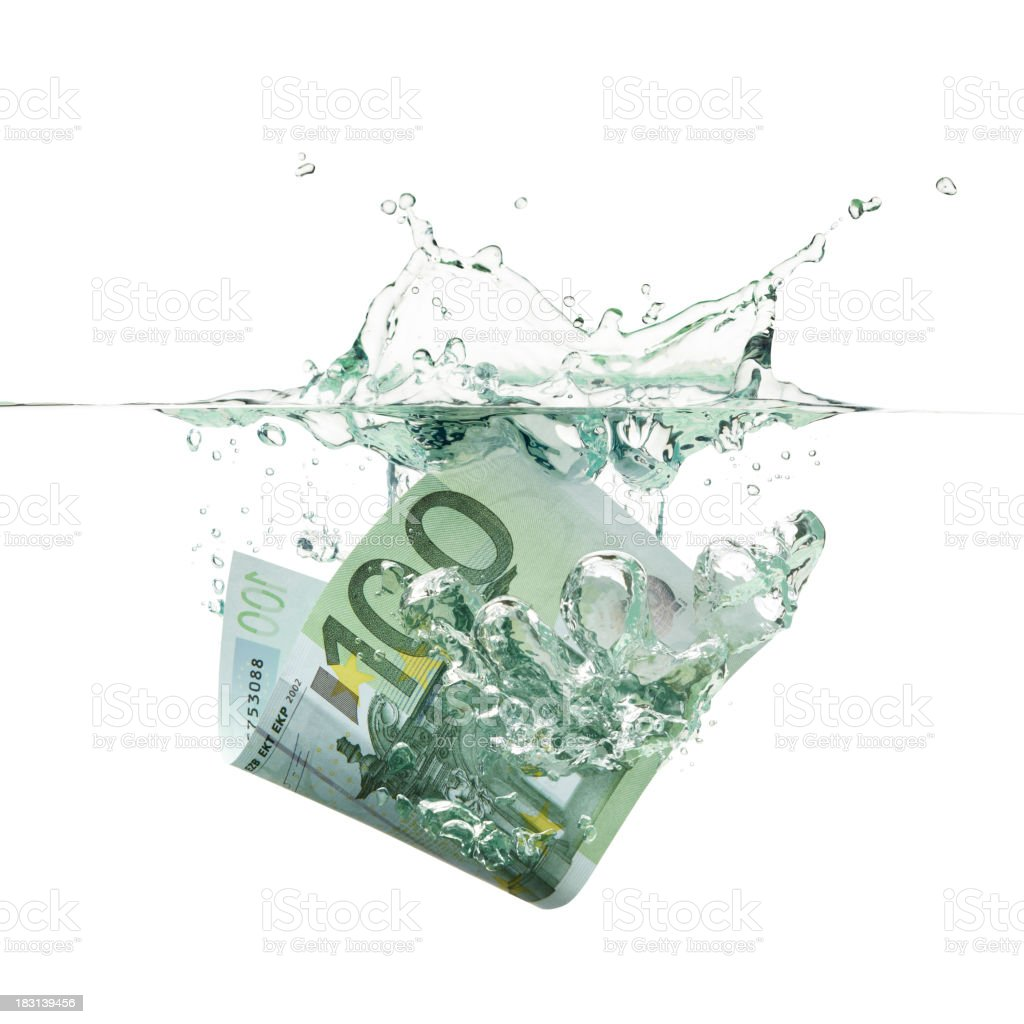 An euro bill splashing into the water as money depreciation royalty-free stock photo