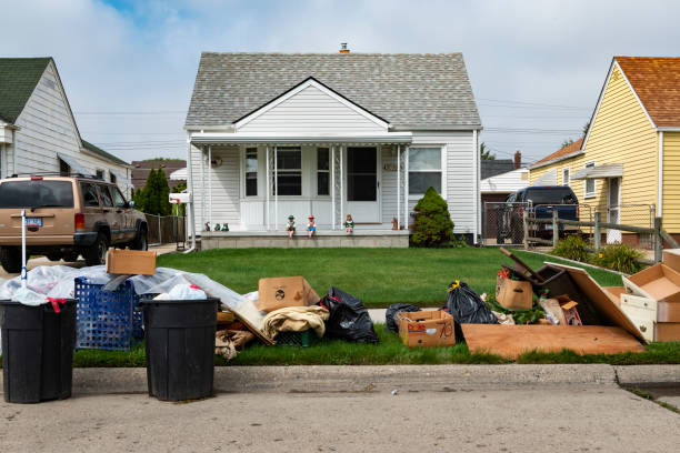 An evicted house at a suburban street with left belongings on the lawns near the 8 mile road, in the city of Detroit. stock photo