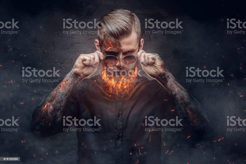 An evil man with burning beard. stock photo