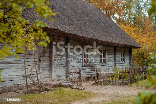 An example of village house of southern Latvia. View of the front garden with hause fasade and enterence.  Latvia. Baltic. Autumn landscape.