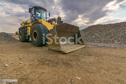 istock An excavator in a stone turning quarry into gravel 1277200463
