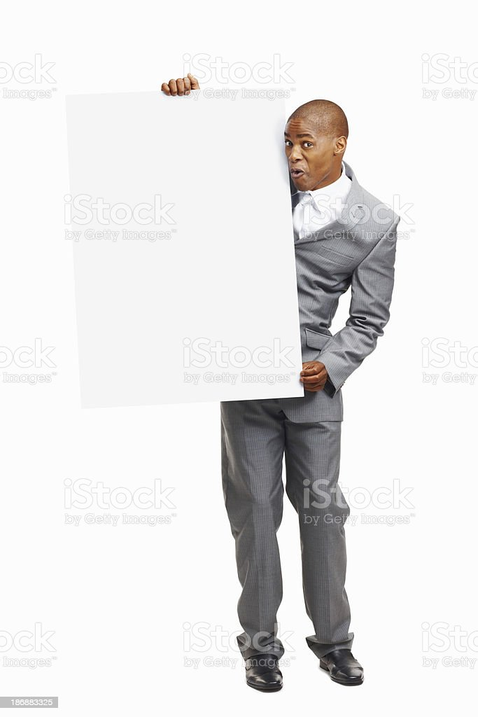 An excited business man holding a billboard against white background royalty-free stock photo