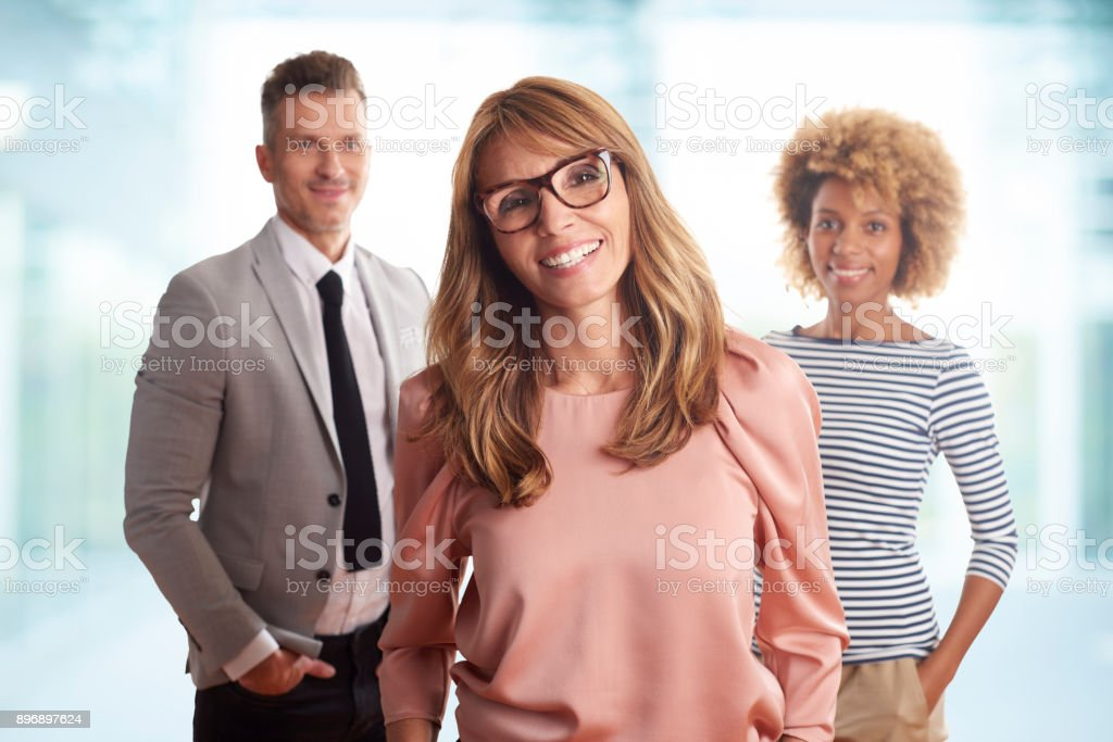 An executive group of business people smiling to the camera stock photo