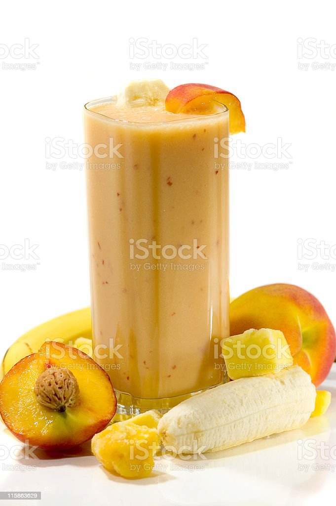 An exotic smoothie with apricots, mangos, and bananas royalty-free stock photo