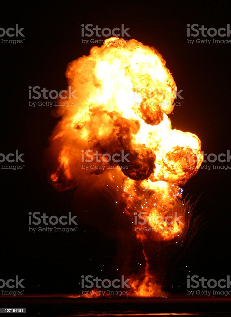 An explosion lit up the darkness with red and yellow flames stock photo
