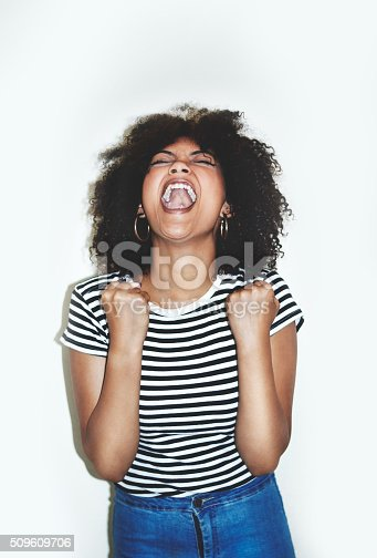 Studio shot of a young woman screaming in anger against a gray backgroundhttp://195.154.178.81/DATA/i_collage/pi/shoots/806347.jpg