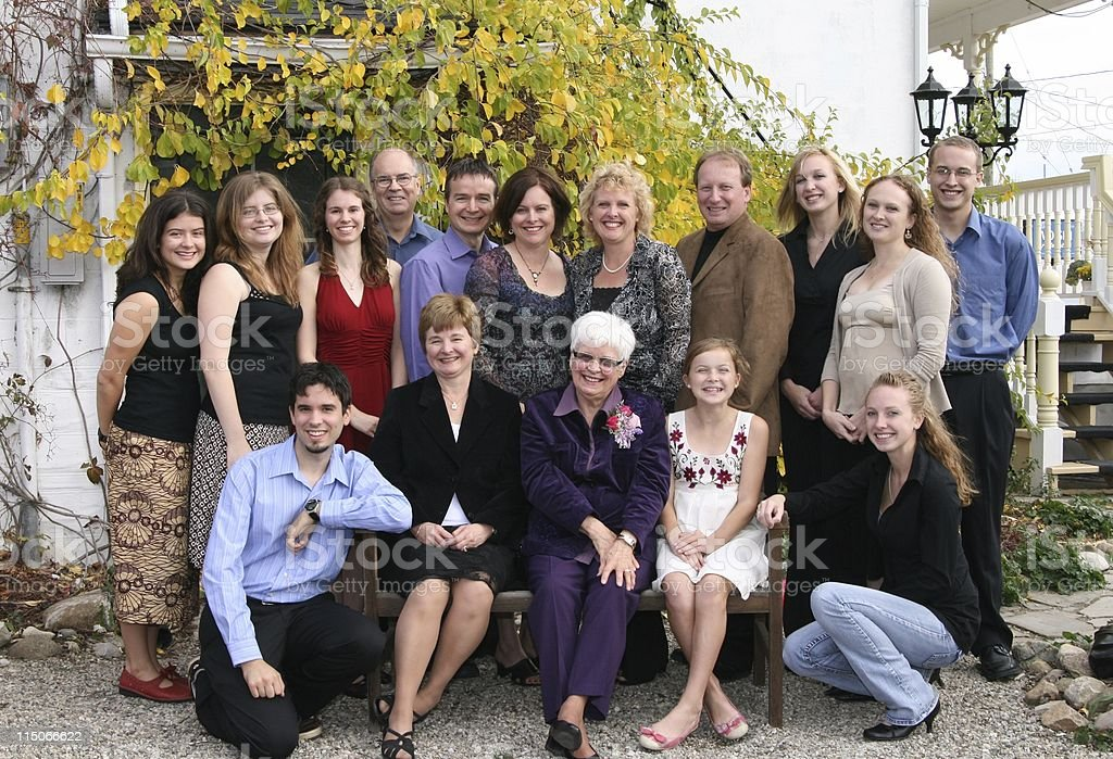 An extended family portrait outside a house stock photo