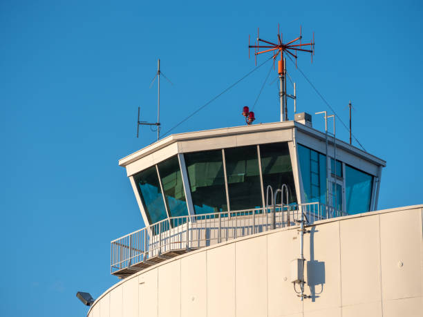 An exterior of an old and abandoned air traffic control tower from the 1930s'. VHF radio antennas on top of the roof. stock photo