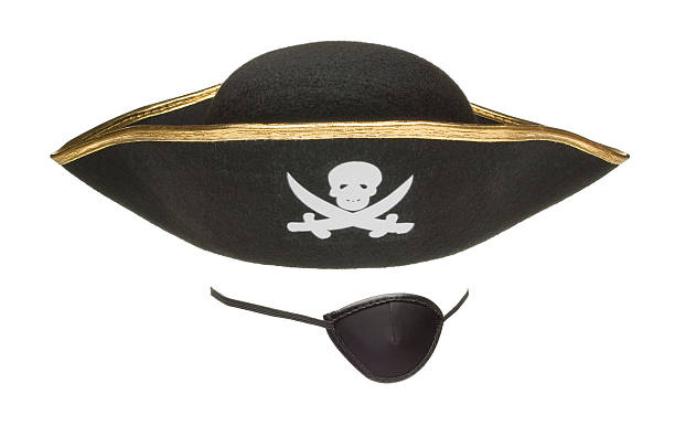 An eye patch and a pirates hat A black eye patch and a pirate hat. costume eye patch stock pictures, royalty-free photos & images