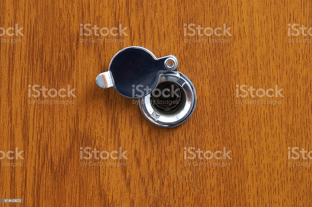 An eye peephole on a fire resistant door stock photo