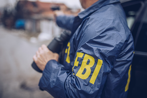An FBI agent uses a gun in action
