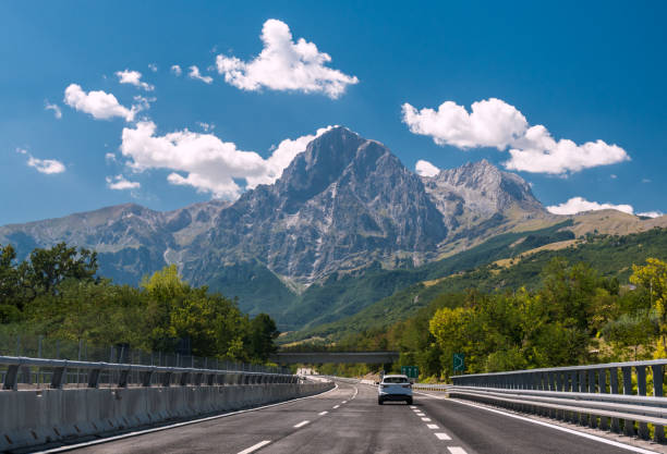 An highway in Italy; the mountain Gran Sasso in background stock photo