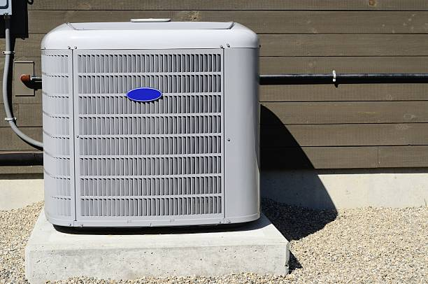 An HVAC on the exterior of a building stock photo