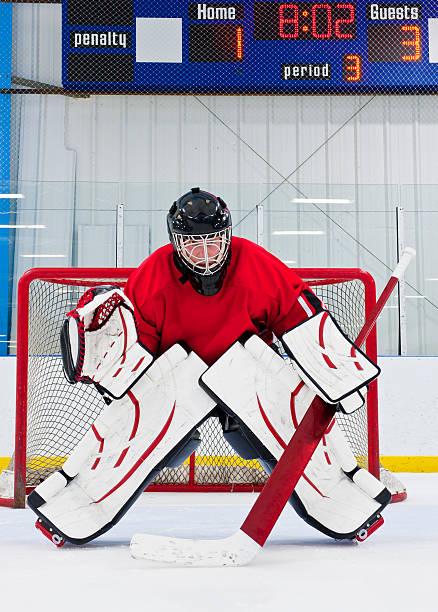 An ice hockey goalie defending his team's goal