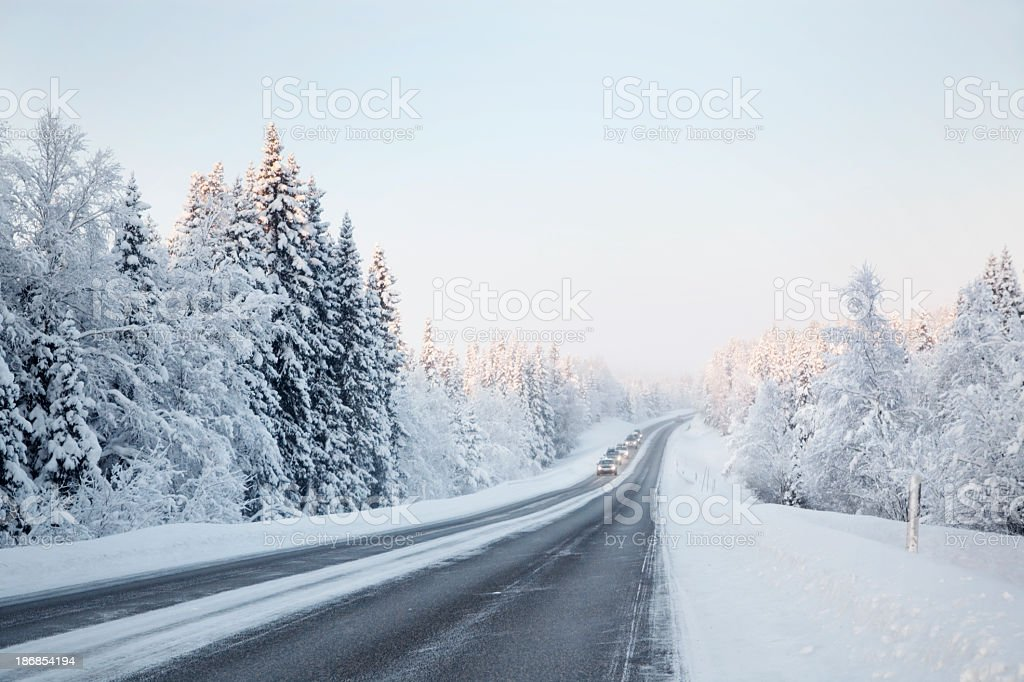 An icy road in a winter landscape stock photo