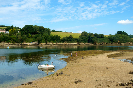 An idyllic summer morning by the creek at St Just in Roseland, Cornwall, UK