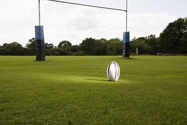 eine beleuchtete rugby-ball auf einem rugby-spiel - rugby stock-fotos und bilder