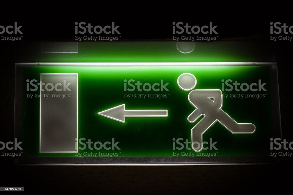 An illuminating emergency exit sign royalty-free stock photo