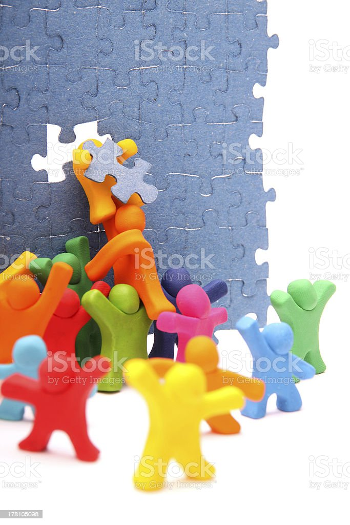 An illustration of a team solving a puzzle stock photo