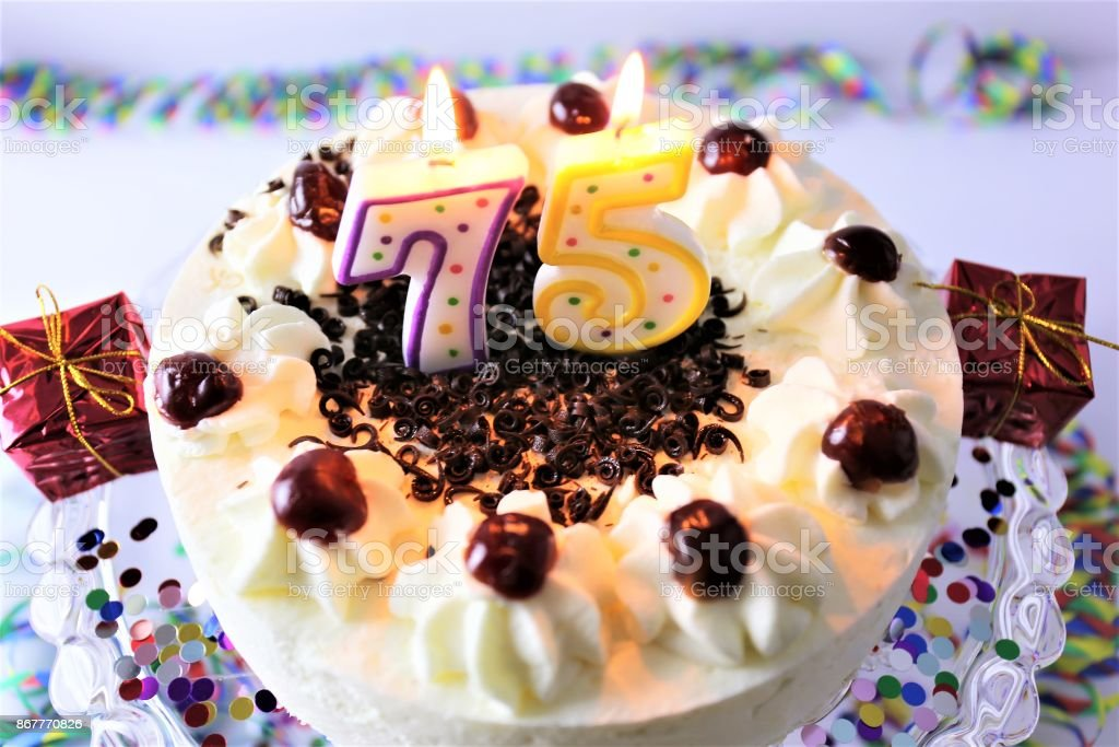 An Image of a birthday cake with candle - 75 stock photo