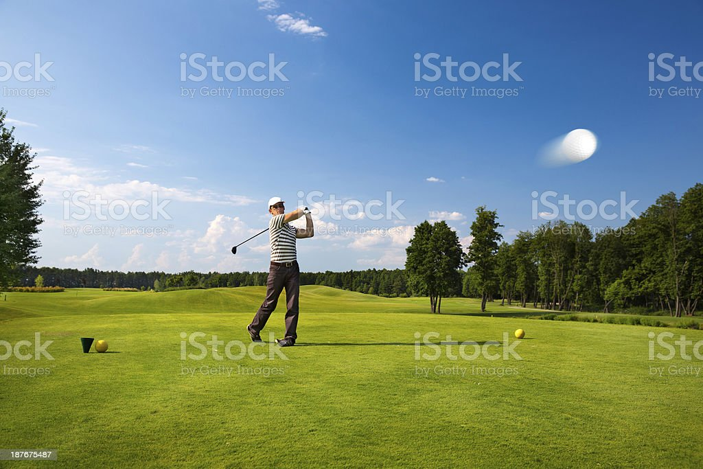 An image of a male golf player stock photo