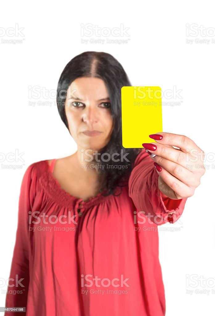 An image of a pretty woman showing yellow card. stock photo