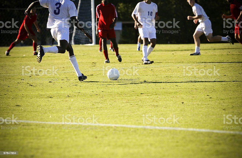 An image of a soccer match in action stock photo