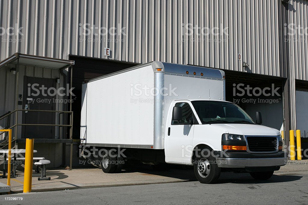 An image of a white delivery truck stock photo