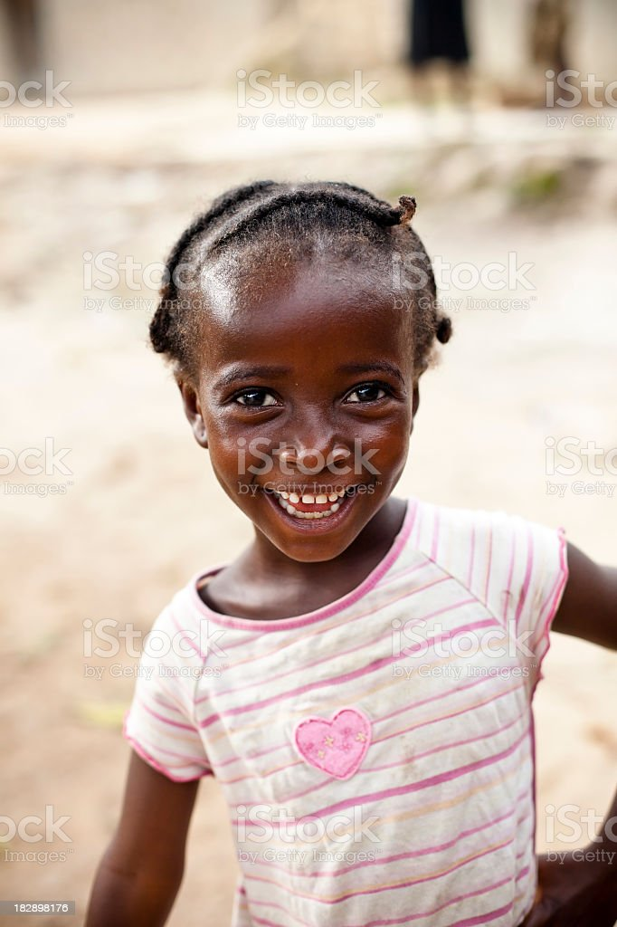 An image of an African little girl smiling royalty-free stock photo