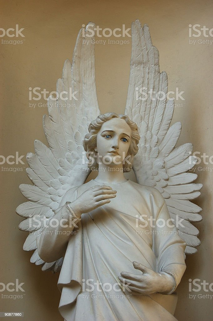 An image of an angel sculpture in marble stock photo