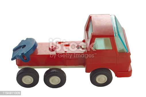 An image of an old toy truck without a trailer isolated on a white