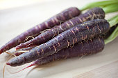 istock An image of four purple nutritious carrots 157638319