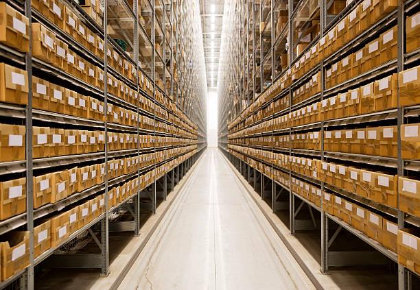 An image of long endless warehouse isle stock photo