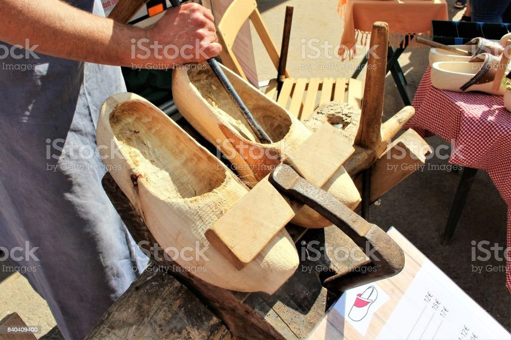 An image of making wooden clogs stock photo