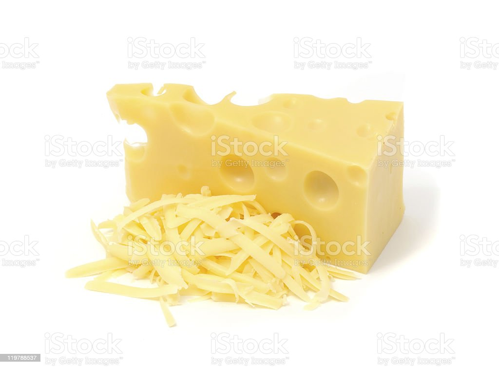 An image of Swiss cheese with some grated stock photo
