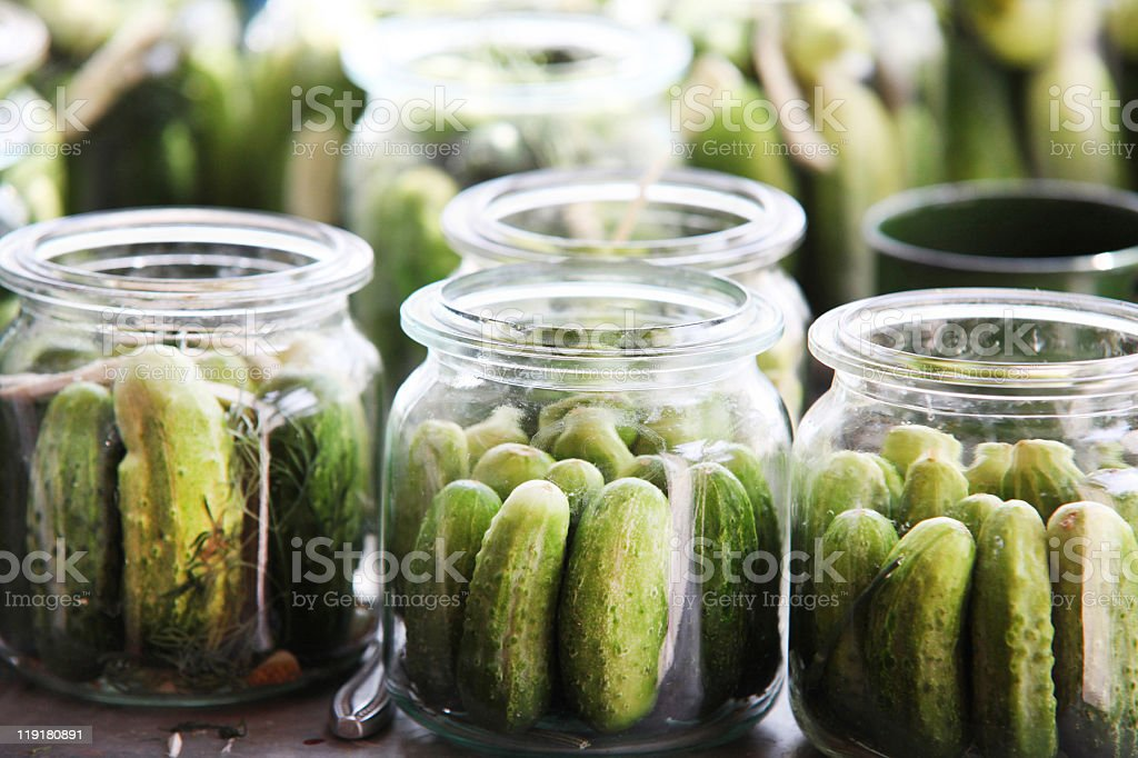 An imagine of cucumbers in jars ready to be pickled stock photo